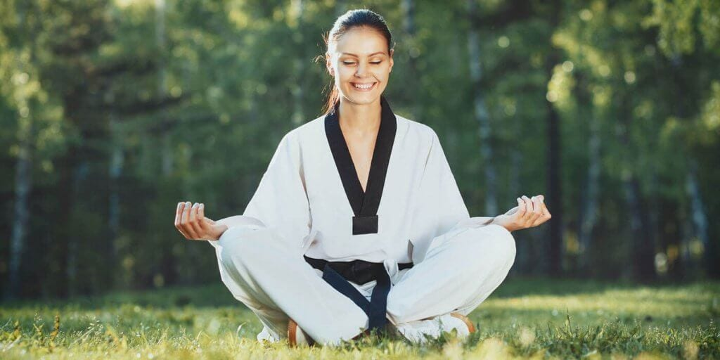 Martial Arts Lessons for Adults in _Cobourg_ _ON_ - Happy Woman Meditated Sitting Background