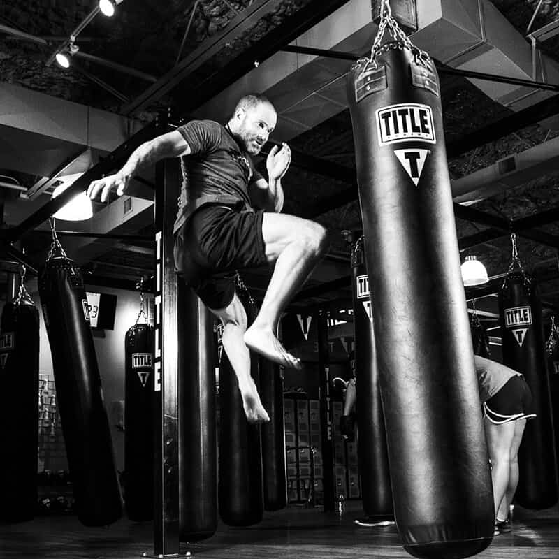 Mixed Martial Arts Lessons for Adults in _Cobourg_ _ON_ - Flying Knee Black and White MMA